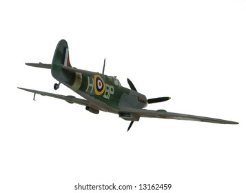 Spitfire Mk IX plane, remote control model airplane, isolated on white background flying away