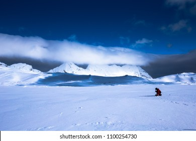 Spitsbergen, Norway - Apr 24 2016: Scientist collecting snow samples from the Hansbreen glacier