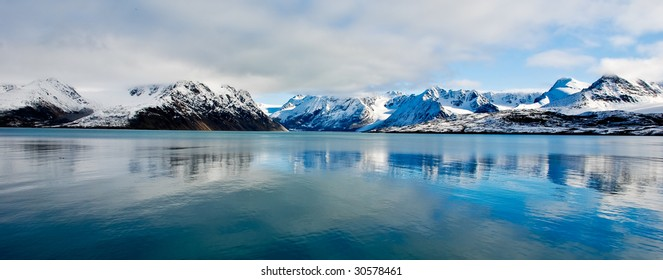 Spitsbergen reflection of the mountains in tranquil sea