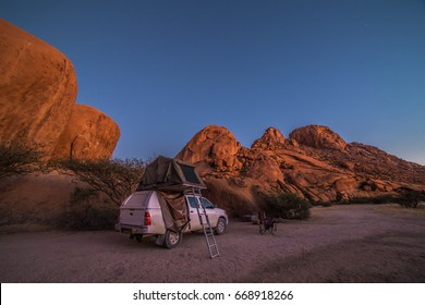 Spitzkoppe, Namibia - 24 MAY 2017: Camping with a 4x4 car (Toyota Hilux) and roof top tent.