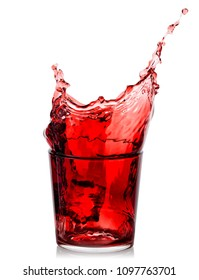 Splash of cherry juice in a low glass isolated on a white background