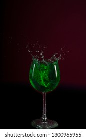 Splash cocktails in green fairy goblet drink in bars and nightlife in Mexico