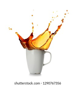 Splash of coffee in cup on white background