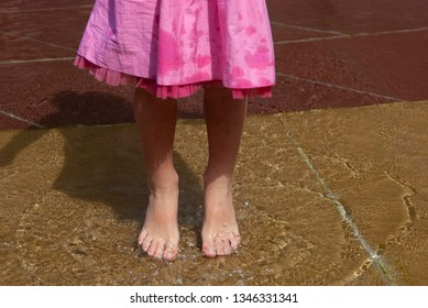 Splash from girl's feet on the water.