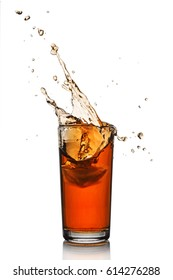 Splash in glass of black tea with ice isolated on white background