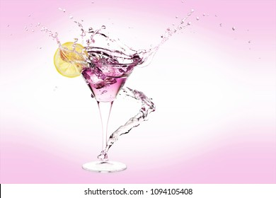 splash of martini drink with lemon slice and ice