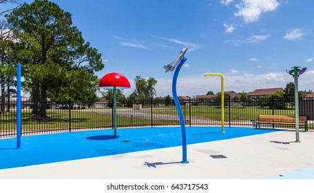 Splash Pad On Air Force Base: Small splash pad on an Air Force Base for resident kids to cool off during the Summer.
