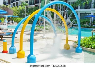 Splash pad or sprayground in pool water park for kids, Children activity background concept