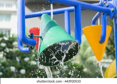 Splash pad or sprayground in water park for kids.