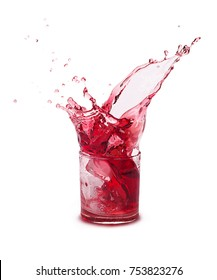 Splash of pomegranate juice in a glass, isolated on a white background