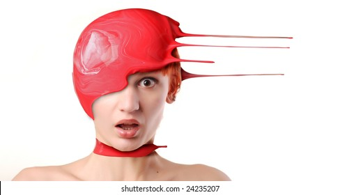 Splash of red paint on shocked woman's head