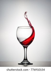 A splash of red wine in the wine glass.
