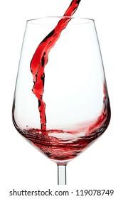 Splash of red wine in a glass. Closeup.