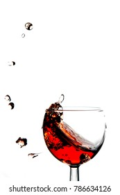 splash. a splash of red wine in a glass. a drop of wine.