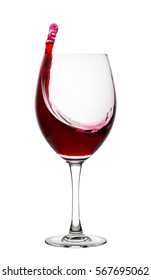 Splash of red wine in a glass isolated on white background
