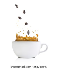 Splash shot of coffee with beans