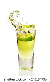 splash of tequila from the falling pieces of lime isolated on white