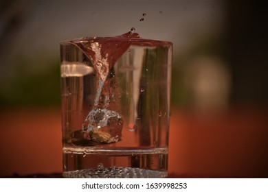 splash of water by stone in a glass