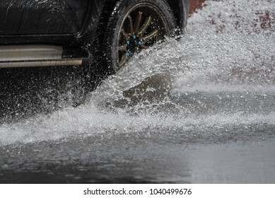 Splash of water from car tire, be careful to drive concept.