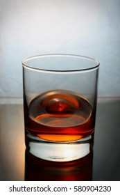splash of whiskey in a glass