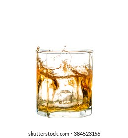 splash of whiskey with ice