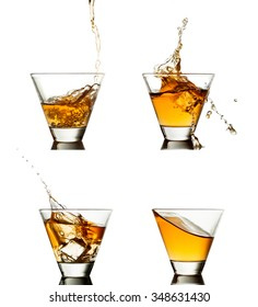 splash of whiskey with ice isolated on white.