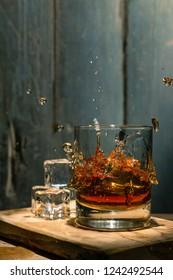 Splash whiskey on ice