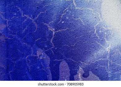 Splashes of blue white paint on the wall surface