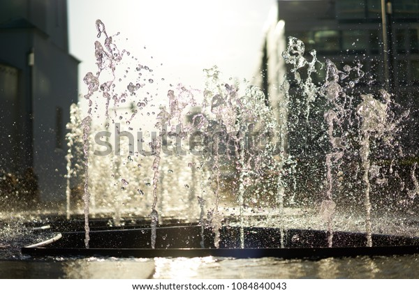 Splashes of fountain water in a sunny day