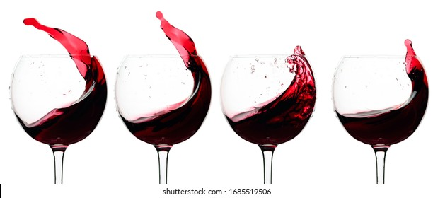 Splashes of red wine in a glasses isolated on a white background.