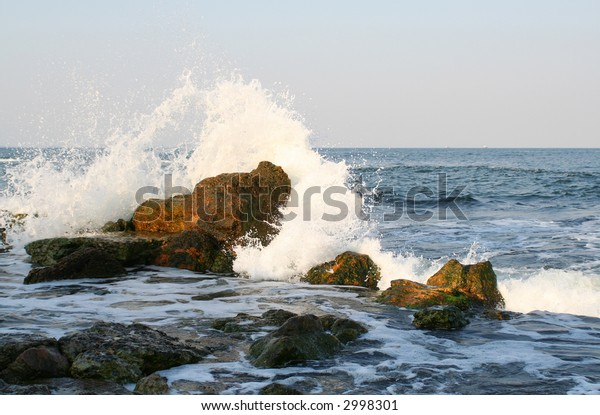 Splashes of the sea wave on the stones