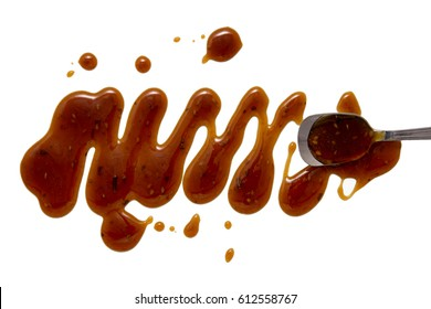 splashes and spilled sweet teriyaki sauce with a spoon. isolated on white background. flat lay, top view