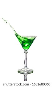 Splashing absinthe liqueur in the glass