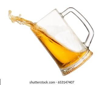 splashing beer in mug isolated on white background