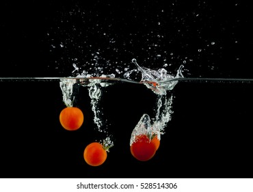 splashing, fresh fruit, vegetables being shot as they submerged under water