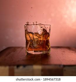 Splashing ice in the whisky
