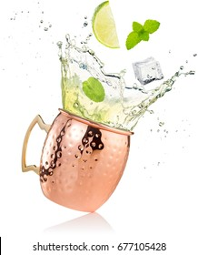 splashing moscow mule cocktail in copper mug isolated