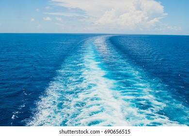 Splashing trail in ocean after cruise ship