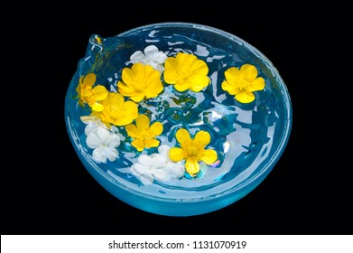 Splashing Water in Blue Bowl With Flowers
