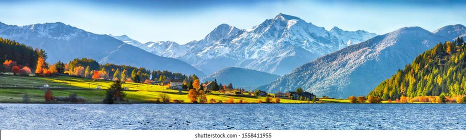 Splendid autumn panorama of Haidersee (Lago della Muta) lake with Ortler peak on background.Location: Lago della Muta or Haidersee, South Tyrol province, Region Trentino-Alto Adige, Italy, Europe