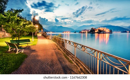 Splendid evening cityscape of Stresa town. Wonderful summer susnset on Maggiore lake with Bella island on background, Province of Verbano-Cusio-Ossola, Italy, Europe. Traveling concept background.