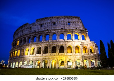 Splendid evening Coliseum or Amphitheatrum Flavium with bright illumination on blue sky background, Rome, Italy