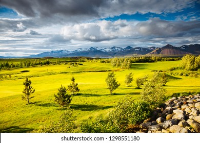 Splendid Iceland landscape with golf course in sunny day. Location place Borgarnes, western Iceland, Europe. Scenic image of beautiful nature landscape. Holiday season. Discover the beauty of earth.