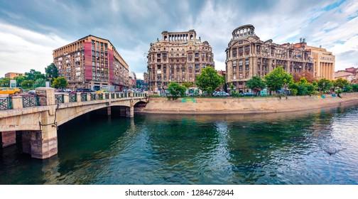 Splendid morning cityscape of Bucharest city - capital of Romania, Europe. Nice summer view of Dambovita River. Traveling concept background.
