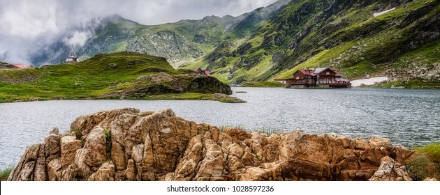 Splendid  mountain landscape .resort on lake in the mountains. location, Balea lake. Transfagarasan highway, the most beautiful road in Europe, Romania, Ridge Fagaras. Transfagarasan road