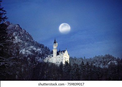 Splendid night scene of royal castle Neuschwanstein and surrounding area in Bavaria, Germany (Deutschland). Famous Bavarian destination sign at snowy winter evening.