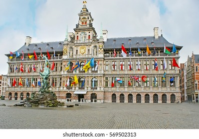 The splendid Renaissance building of the Stadhuis (City Hall) is the pearl of the Grote Markt Square, the Brabo Fountain located in front of its facade, Antwerp, Belgium.