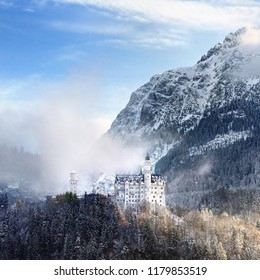 Splendid scene of royal castle Neuschwanstein and surrounding area in Bavaria, Germany (Deutschland). Famous Bavarian destination sign at sunny snowy winter day.