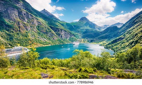 Splendid summer scene of Geiranger port, western Norway. Aerial morning view of Sunnylvsfjorden fjord. Traveling concept background. Artistic style post processed photo.