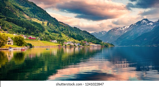 Splendid summer sunrise in Lofthus village in Ullensvang municipality which is located in the Hardanger region of Hordaland county, Norway. Beauty of countryside concept background.